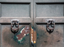 Old Door with Knockers and Keyhole Royalty Free Stock Images
