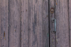 Old door in La Palma  Island in lilac with iron handle . Tempting ld door in La Palma with rude wooden structure in lilac color Royalty Free Stock Photos