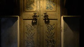 An old door with large handles and a in a vintage style. Approach to the old door in vintage style with large handles stock video footage