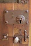 Old door lock. Old wooden door bronze lock and handle Royalty Free Stock Image
