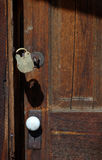 Old Door and Lock. Old weathered door and brass lock stock images