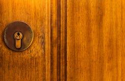 Old door lock, aged wooden door, home security stock photography