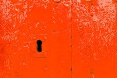 Old door lock, aged wooden door, home security royalty free stock photo