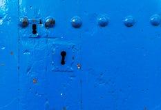 Old door lock, aged wooden door, home security stock photo