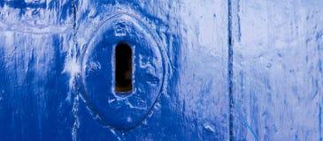 Old door lock, aged wooden door, home security royalty free stock photos