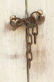 Old door with lock and chain Stock Images