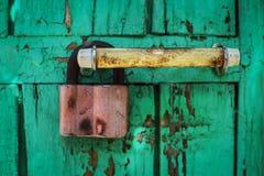 Old door lock handle. Door lock handle door paint dirt retro Stock Images