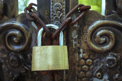 Old door and lock. Very old bronze  door with a latch and lock Royalty Free Stock Image