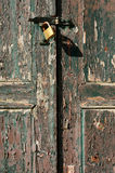 Old door locked. Closeup view of an old door with a safelock Royalty Free Stock Image