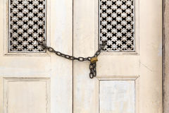 Old door locked Stock Images