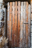 Old door made from rough planks of wood. Royalty Free Stock Photo