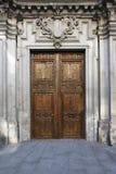 Old door in majestic building entrance Stock Photos
