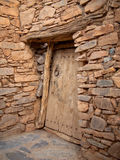 Old door in masonry. With a ring Royalty Free Stock Photo