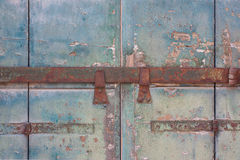 An old door with a metal bolt. An old wooden door with a metal bolt in Venice, Italy Royalty Free Stock Images