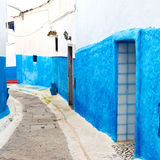 old door in morocco africa ancien and wall ornate   blue street Royalty Free Stock Photos