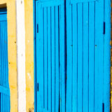 old door in morocco africa ancien and wall ornate blue yellow Stock Photography