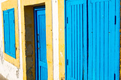 old door in morocco africa  wall ornate blue yellow Stock Image