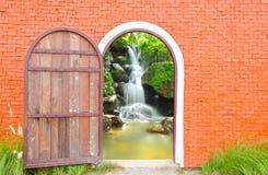 Old door is open. Old door wooden is open to waterfall wall stock photography