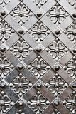 Old door with ornament in stone wall. Stock Photo