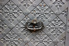 Old door with ornament in stone wall in Royal Wawel Castle, Cracow, Poland Stock Images