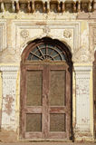 Old door and ornate wall in India Royalty Free Stock Photography