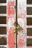 Old door and pad lock Stock Photo