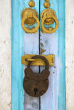 Old door with padlock and golden details. Royalty Free Stock Photography