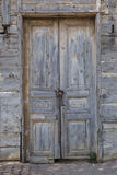 An old door with padlocks on a chain Royalty Free Stock Photography