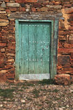 Old door painted in green Royalty Free Stock Image