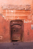 Old door at a red house in Marrakesh Royalty Free Stock Image
