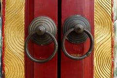 Old door ring handle. On red wooden door Royalty Free Stock Photo
