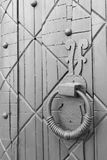 Old door round hanging handle knocker detail.  royalty free stock photography