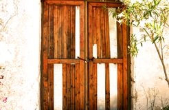 Old door in Ruin. Broken frame. Wooden frames. Abandoned house. Door with lock and chains. Lindos, Rhodes, Greece Royalty Free Stock Photos