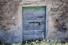 Old door. Ruins of an old country house Royalty Free Stock Images
