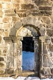 Old door in the ruins of St. Olav`s Church in Bamble, Norway. stock photos