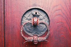 Old door with rustic, interesting doorknob. Wooden,old,vintage door with rustic, bearded man maybe Santa doorknob. Nirenberg, Germany Royalty Free Stock Images