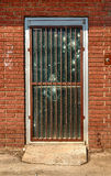 Old Door With Rusty Bars and Bullet Holes Stock Image