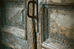 An old door with a rusty handle and a keyhole stock photos