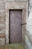 Old Door. Old rusty door in medieval church Royalty Free Stock Photo