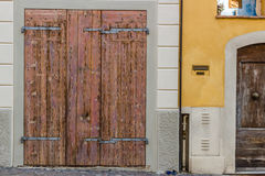 old door with rusty nails and peeling copal Royalty Free Stock Images