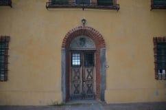 Old door`s house now is uninhabited stock photo