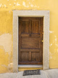 Old door in Saluzzo. Old port in the historic center of Saluzzo Royalty Free Stock Image