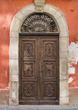 Old door in Saluzzo. Old port in the historic center of Saluzzo Royalty Free Stock Images
