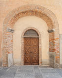 Old door in Saluzzo. Old port in the historic center of Saluzzo Royalty Free Stock Photography