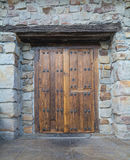 Old door, Spain. Ancient wooden door on a stone made wall Royalty Free Stock Images