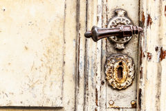 Old door with squiggly jack Royalty Free Stock Photo