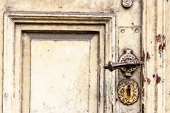 Old door with squiggly jack Stock Images
