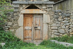 Old door. On stone house Stock Photography