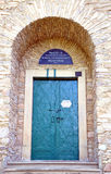 Old door. In a stone wall Stock Image