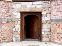 Old door in stone wall Stock Image
